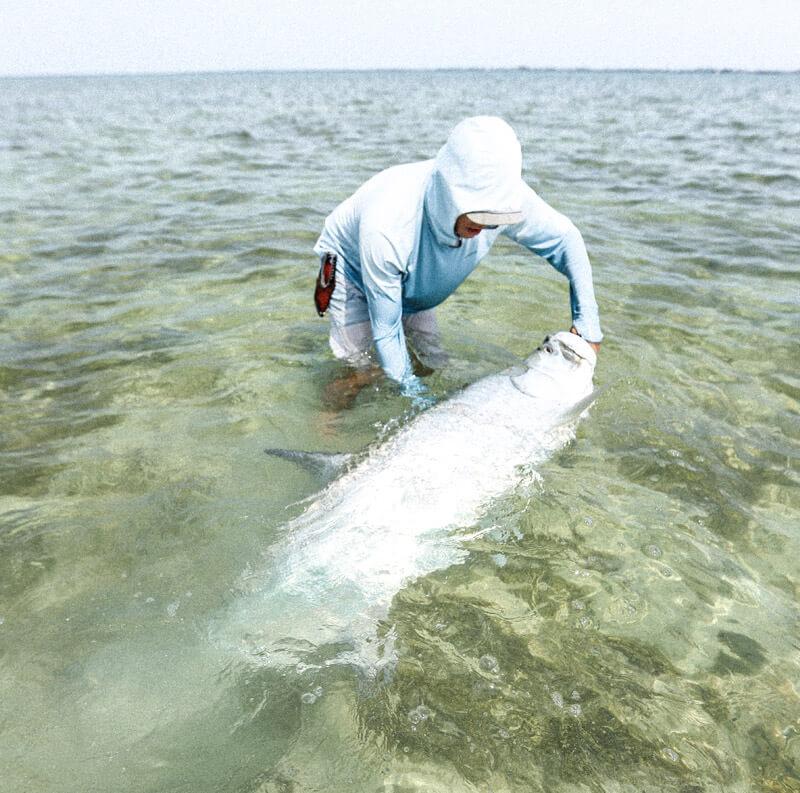 An image of an angler landing a large Florida Keys Tarpon on an Outgoing Angling Florida Keys Fishing Charter