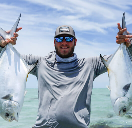 An image of an Outgoing Angling fisherman with twin permit in the Florida keys.
