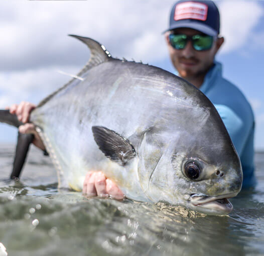 An image of anglers catching a beautiful tarpon in the fabulous Florida Keys with Outgoing Angling
